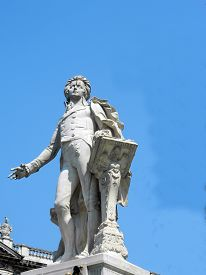 stock photo of mozart  - Statue of Wolfgang Amadeus Mozart Burggarten in Vienna Austria at the back of Hofburg winter palace - JPG