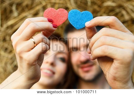 Couple Of Lovers Is Holding Hearts In Their Hands