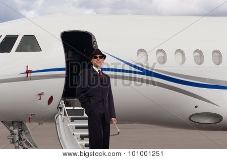 Man by a private jet