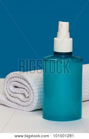 Spray bottle with towel