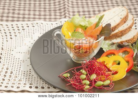 Fresh Vegetable Salad In Transparent Bowl And Whole Wheat