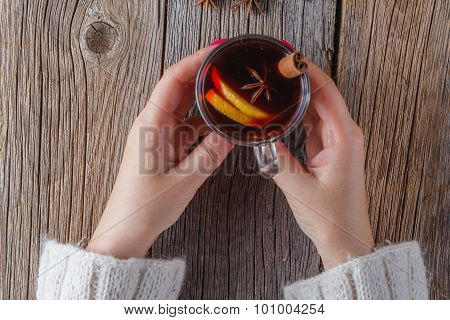 Mulled Wine And Spices On Weathered Wooden Table
