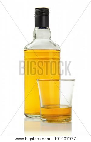 A Glass and Bottle of Alcoholic Drink on White Background