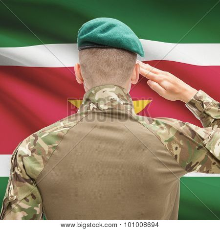 National Military Forces With Flag On Background Conceptual Series - Suriname