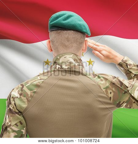 National Military Forces With Flag On Background Conceptual Series - Tajikistan