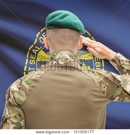 Soldier Saluting To Usa State Flag Conceptual Series - Nebraska