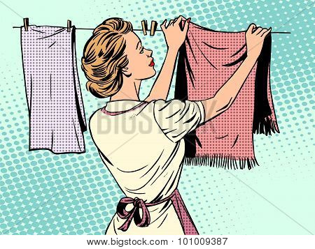 woman hangs clothes after washing housewife housework comfort