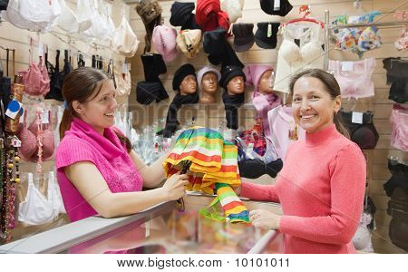 Saleswoman And Customer  At  Counter
