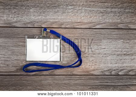 Name id card badge with cord (rope) on wooden table