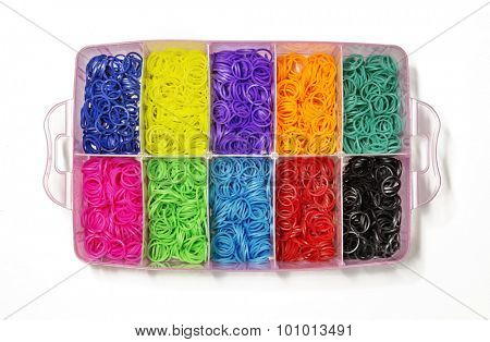 Colorful of elastic rainbow loom bands on white background