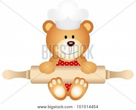 Teddy bear holding rolling pin