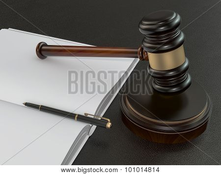 Wooden Judges Gavel And Open Book On Black Leather Desk