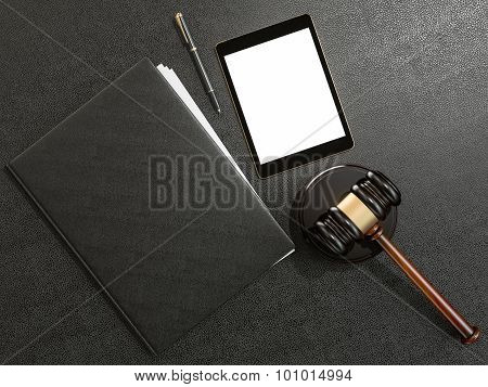 Wooden Judges Gavel And Tablet Computer On Black Leather Desk