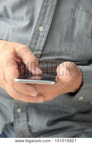 Man with thumb on smartphone
