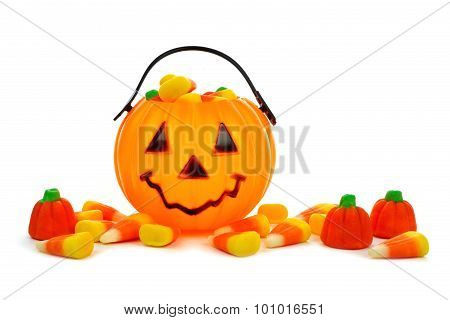 Halloween Jack o Lantern candy collector with scattered candies