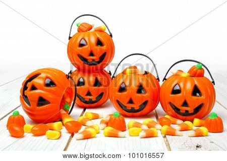 Halloween Jack o Lantern candy holders on white wood