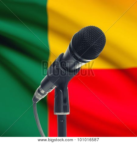 Microphone On Stand With National Flag On Background - Benin