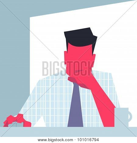 Businessman sitting in front of computer.