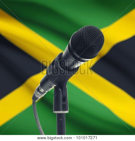 Microphone On Stand With National Flag On Background - Jamaica