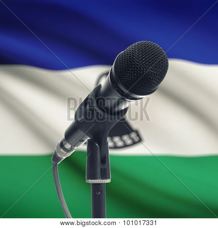 Microphone On Stand With National Flag On Background - Lesotho