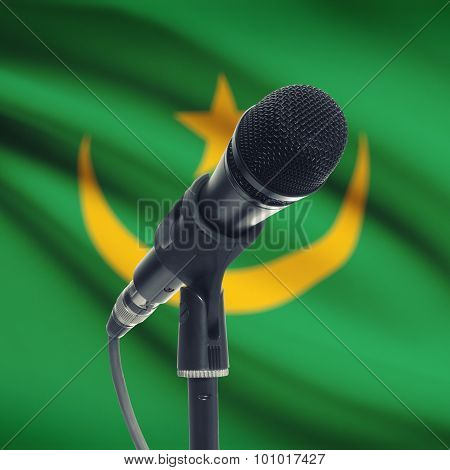 Microphone On Stand With National Flag On Background - Mauritania