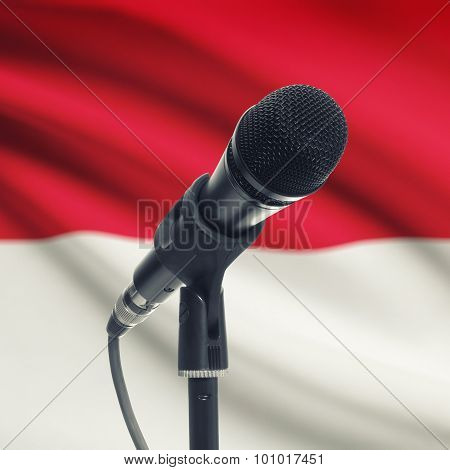 Microphone On Stand With National Flag On Background - Monaco