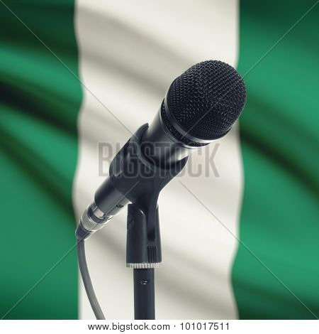 Microphone On Stand With National Flag On Background - Nigeria