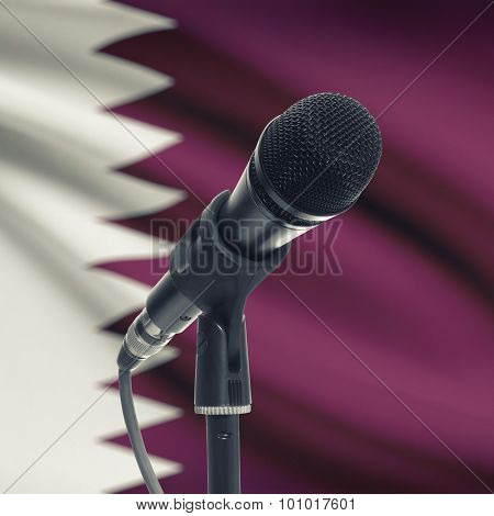 Microphone On Stand With National Flag On Background - Qatar