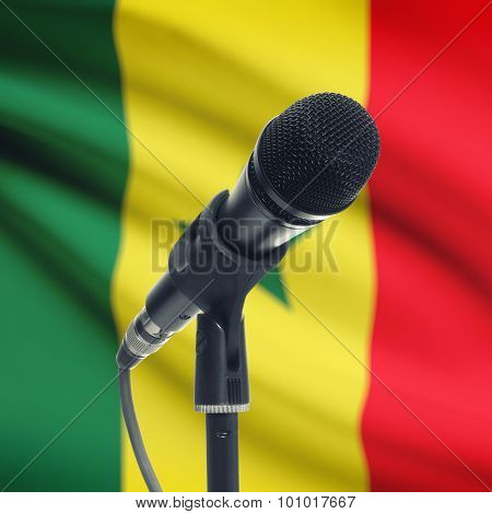 Microphone On Stand With National Flag On Background - Senegal