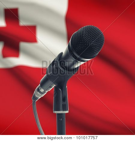 Microphone On Stand With National Flag On Background - Tonga