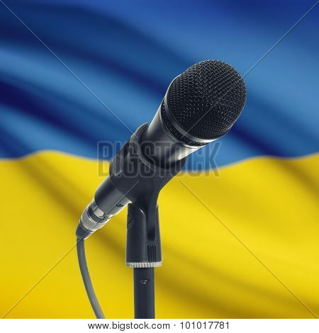 Microphone On Stand With National Flag On Background - Ukraine