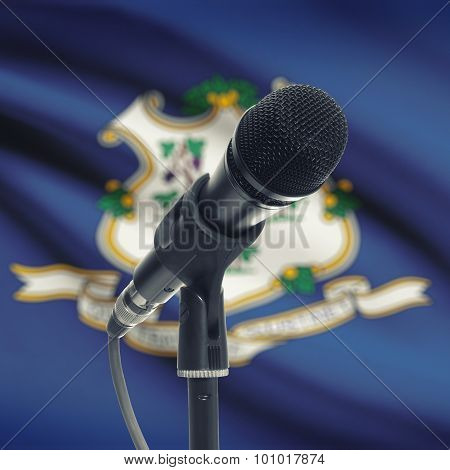 Microphone On Stand With Us State Flag On Background - Connecticut