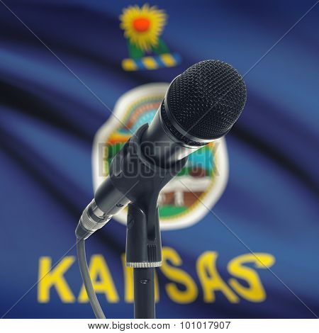 Microphone On Stand With Us State Flag On Background - Kansas
