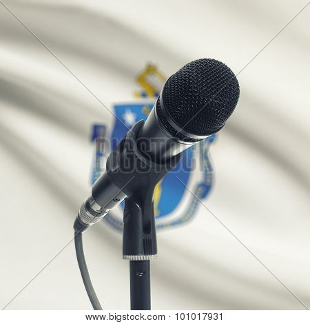 Microphone On Stand With Us State Flag On Background - Massachusetts