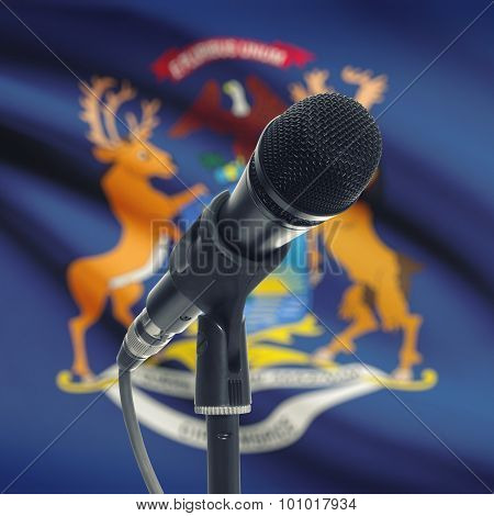 Microphone On Stand With Us State Flag On Background - Michigan