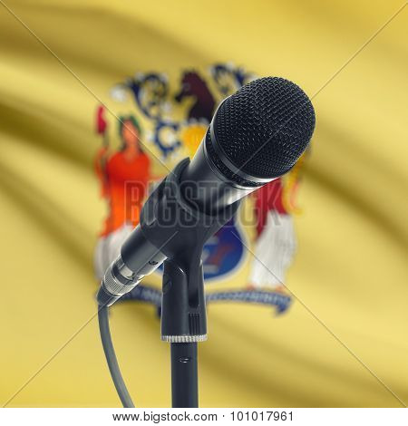 Microphone On Stand With Us State Flag On Background - New Jersey