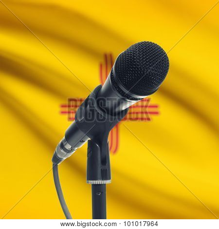 Microphone On Stand With Us State Flag On Background - New Mexico