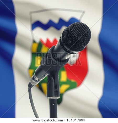 Microphone On Stand With Canadian Province Flag On Background - Northwest Territories