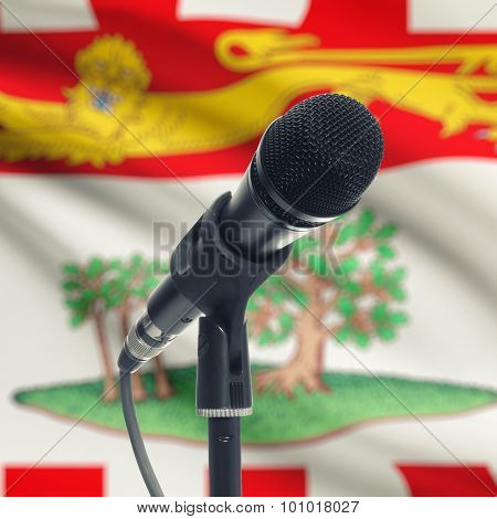 Microphone On Stand With Canadian Province Flag On Background - Prince Edward Island