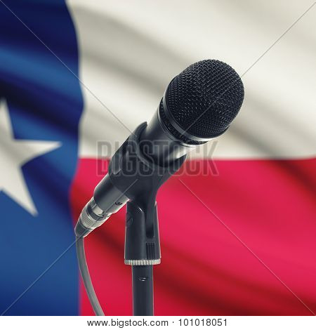 Microphone On Stand With Us State Flag On Background - Texas