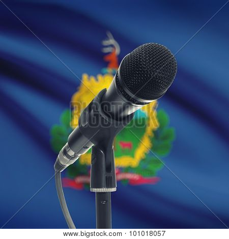 Microphone On Stand With Us State Flag On Background - Vermont