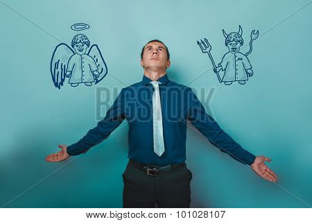 man businessman arms outstretched looking up with an angel on hi