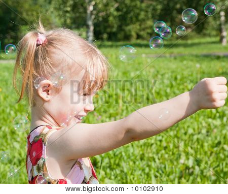 Girl Catches The Bubbles, Happy And Laughs