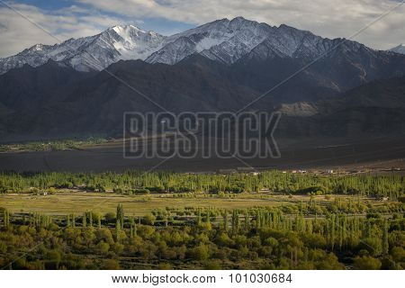 Scenic view of snow mountain at sunset