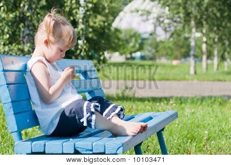 Dreamy Girl On A Park Bench