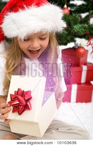 Excited Little Girl Opening Christmas Present