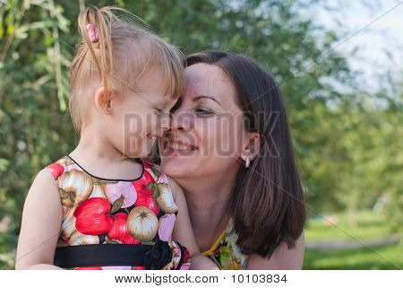 Mother And Daughter Hugging, Kissing And Happy