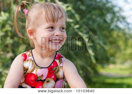 Portrait Of Happy And Smiling Little Girl
