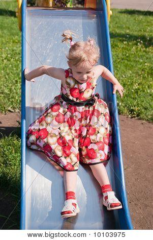 Girl Riding A Roller Coaster
