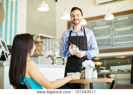 Handsome Waiter Doing His Job